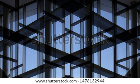 Glass wall with metal framework. Reworked photo of office building exterior or interior fragment. Windows as abstract modern architecture background with geometric structure with blue sky. Royalty-Free Stock Photo #1476132944