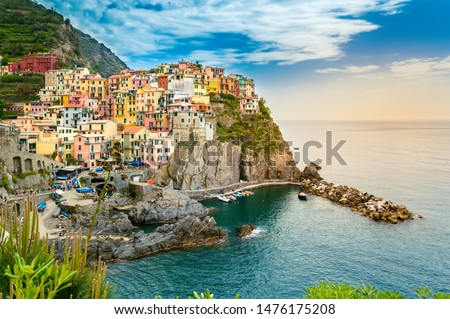 Manarola, Cinque Terre - romantic small village with colorful buildings on cliff overlooking sea. Cinque Terre National Park with rugged coastline is famous tourist destination in Liguria, Italy #1476175208