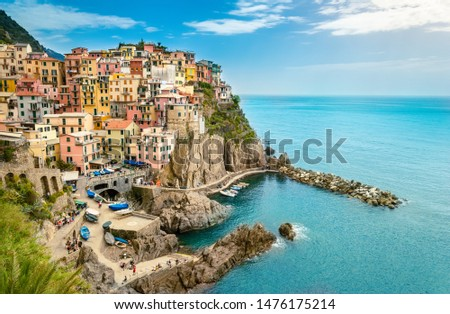 Manarola, Cinque Terre - romantic small village with colorful buildings on cliff overlooking sea. Cinque Terre National Park with rugged coastline is famous tourist destination in Liguria, Italy #1476175214