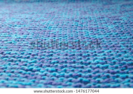 Blue knitted background. Knitted texture. A sample of knitting. Knitting Pattern. #1476177044