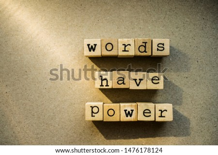 words  Words Have Power written in  wooden alphabet letters isolated on an craft paper - carton background with empty copy space. ray of sunshine #1476178124