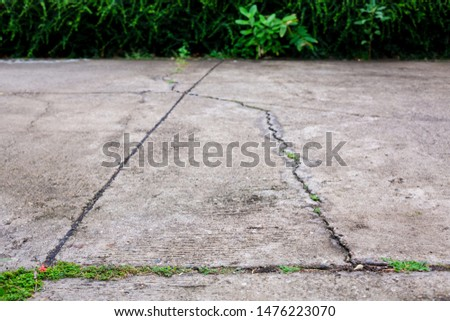 Worn and cracked asphalt with big cracks. Old road concrete texture with cracks. Cement cracked background. Cracks on concrete. #1476223070