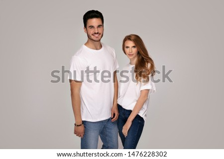 Beautiful young happy couple isolated on studio background. Facial expression, human emotions, advertising concept. Man and woman posing together.Love and friendship. #1476228302