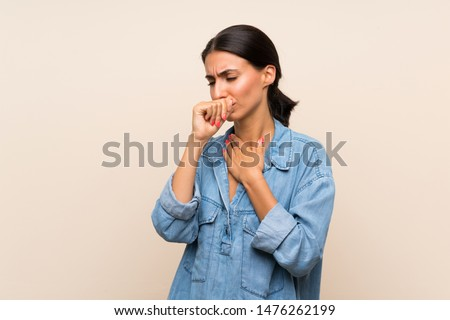Young woman over isolated background is suffering with cough and feeling bad Royalty-Free Stock Photo #1476262199