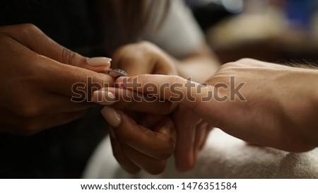 Man getting a manicure in a spa #1476351584