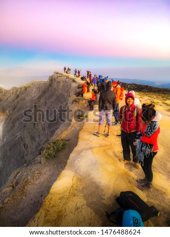 East Java, Indonesia. July 29, 2019. Tourists are walking up to the top of the Kawah Ijen volcano to see the sunrise scenery in the morning. #1476488624