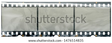 real high res 35mm filmstrip with empty frames or cells in foil on white #1476514835