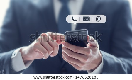 CONTACT US, Hand of Businessman holding mobile smartphone with ( mail,phone,email ) icon. customer support concept, copy space. #1476528185