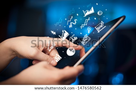 Hand holding tablet with online business report concept #1476580562