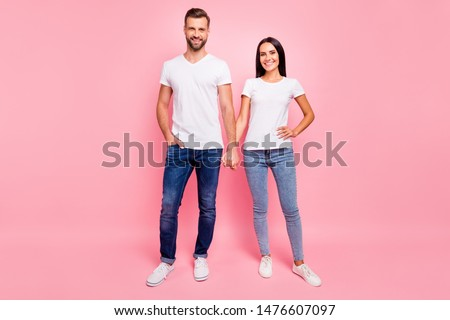 Full length body size photo of glad funky couple standing hand in hand while isolated with pastel background #1476607097