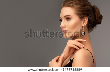 Beautiful girl . Fashionable and stylish woman in trendy jewelry big earrings .  Fashion look  , beauty and style. Natural makeup & easy styling #1476718889