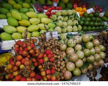 VIETNAM, SAIGON – December 22,2017: Many types of fresh fruit for sale  in Ben Thanh Market Ho Chi Minh City Vietnam. #1476748619