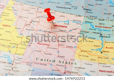 Red clerical needle on a map of USA, Montana and the capital of Helena. Close up Montana map with red tack #1476922253