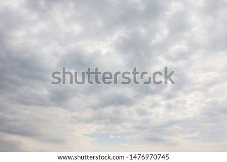 Gray clouds in the sky before the rain. Workpiece for design Royalty-Free Stock Photo #1476970745