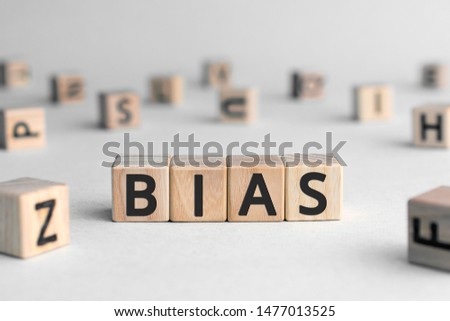 Bias - word from wooden blocks with letters, personal opinions prejudice bias concept, random letters around, white  background #1477013525