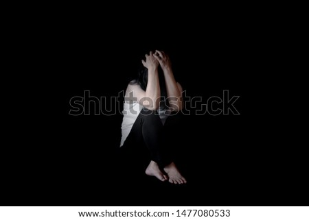 Young woman sitting on floor in dark room, depressed woman, Stop violence against women,International women's day photos
