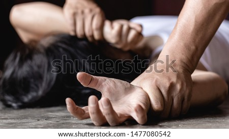 Image for rape and sexual abuse concept.Sexual abuse is a problem or Social issues concept. male hand holding a woman hand for rape and sexual abuse. #1477080542
