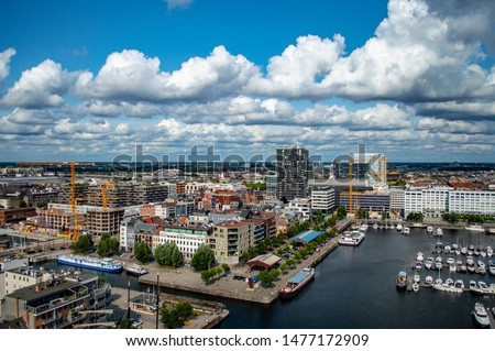 Aerial view of the city of Antwerp in Belgium on a sunny summer day with beautiful clouds. #1477172909