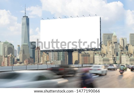 Advertising concept, Blank template  for outdoor advertising or blank billboard on the highway in city. With clipping path on screen - can be used for trade shows, promotional poster. #1477190066