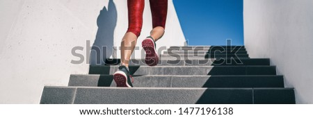 Cardio runner woman going up step of stairs at outdoor staircase for uphill hiit workout training exercise. Banner panoramic running shoes closeup. #1477196138