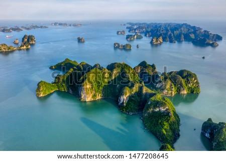 Aerial view Bui Xam area and rock island, Halong Bay, Vietnam, Southeast Asia. UNESCO World Heritage Site. Junk boat cruise to Ha Long Bay. Popular landmark, famous destination of Vietnam  #1477208645