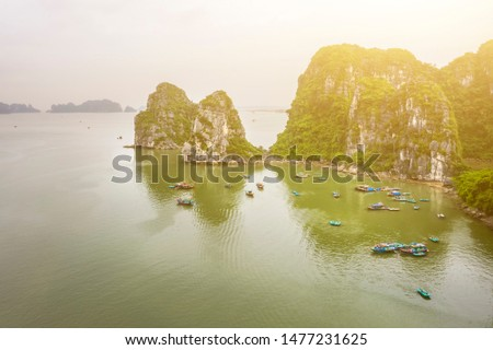 Aerial view Ba Hang floating fishing village, rock island, Halong Bay, Vietnam, Southeast Asia. UNESCO World Heritage Site. Junk boat cruise to Ha Long Bay. Famous destination of Vietnam #1477231625
