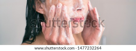 Face wash exfoliation scrub soap woman washing scrubbing with skincare cleansing product panoramic banner. #1477232264