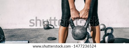 Kettlebell weightlifting woman lifting free weight panoramic banner gym. Hands holding heavy kettle bell for strength training exercise lifestyle. Royalty-Free Stock Photo #1477236524