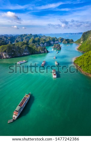Aerial view Vung Vieng floating fishing village and rock island, Halong Bay, Vietnam, Southeast Asia. UNESCO World Heritage Site. Junk boat cruise to Ha Long Bay. Famous destination of Vietnam Royalty-Free Stock Photo #1477242386