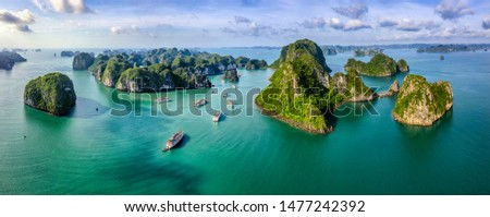 Aerial view Vung Vieng floating fishing village and rock island, Halong Bay, Vietnam, Southeast Asia. UNESCO World Heritage Site. Junk boat cruise to Ha Long Bay. Famous destination of Vietnam Royalty-Free Stock Photo #1477242392
