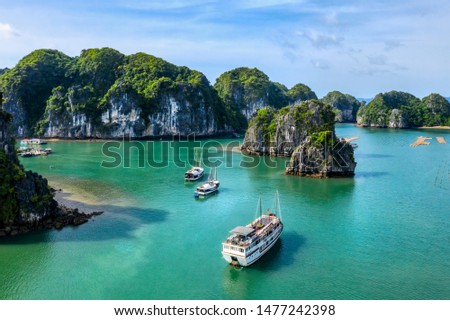 Aerial view Vung Vieng floating fishing village and rock island, Halong Bay, Vietnam, Southeast Asia. UNESCO World Heritage Site. Junk boat cruise to Ha Long Bay. Famous destination of Vietnam Royalty-Free Stock Photo #1477242398
