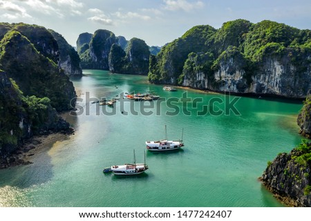 Aerial view Vung Vieng floating fishing village and rock island, Halong Bay, Vietnam, Southeast Asia. UNESCO World Heritage Site. Junk boat cruise to Ha Long Bay. Famous destination of Vietnam Royalty-Free Stock Photo #1477242407