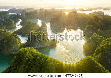 Aerial view Vung Vieng floating fishing village and rock island, Halong Bay, Vietnam, Southeast Asia. UNESCO World Heritage Site. Junk boat cruise to Ha Long Bay. Famous destination of Vietnam Royalty-Free Stock Photo #1477242425