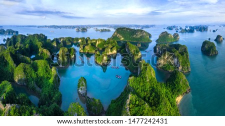 Aerial view Vung Vieng floating fishing village and rock island, Halong Bay, Vietnam, Southeast Asia. UNESCO World Heritage Site. Junk boat cruise to Ha Long Bay. Famous destination of Vietnam Royalty-Free Stock Photo #1477242431