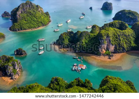 Aerial view Vung Vieng floating fishing village and rock island, Halong Bay, Vietnam, Southeast Asia. UNESCO World Heritage Site. Junk boat cruise to Ha Long Bay. Famous destination of Vietnam Royalty-Free Stock Photo #1477242446