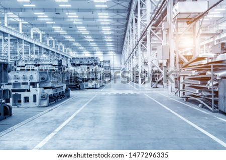 The interior of a big industrial building or factory with steel constructions #1477296335