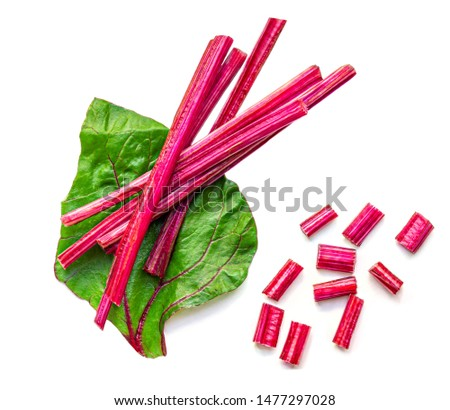 Creative layout made of Fresh Rhubarb or Rheum with stalks, leaves  and pieces  vegetable isolated on white background. Top view. Flat lay  #1477297028