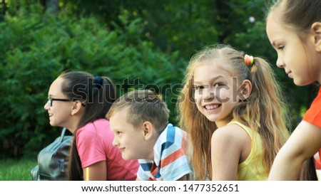 Children lie on the lawn and look one way #1477352651