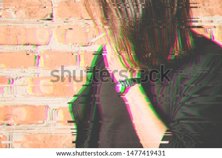 Glitch effect witht pink and green colors . A young man with a cigarette near a bricks wall. Glitch effect. Trend effect. #1477419431