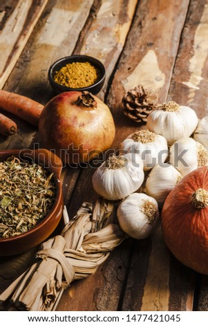High angle autumn food assortment on wooden table #1477421045
