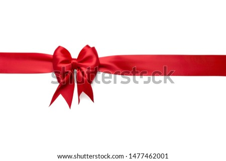 Red horizontal silk ribbon with a red festive beautiful bright bow tied on it isolated on a white background #1477462001