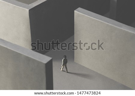 man walking in a complex abstract maze, surreal concept #1477473824