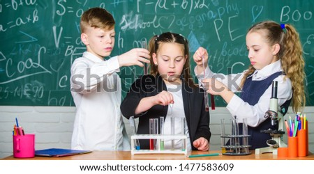 Little kids learning chemistry in school laboratory. students doing biology experiments with microscope in lab. Biology equipment. biology education. Happy children. Biology lesson. #1477583609