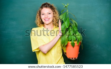 Florist concept. Botany is about plants flowers and herbs. Woman chalkboard background carry plant in pot. Take good care plants. Botany and biology lesson. Botanical expert. Botany education. #1477585523