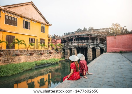 Travel couple with Japanese Covered Bridge,  in Hoi An, Vietnam #1477602650