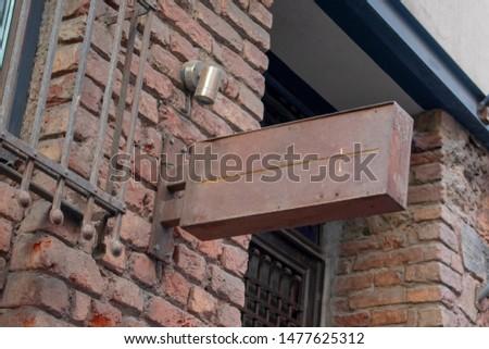 blank signboard on stone wall, copper signboard, aging signboard on brick wall. old copper signboard #1477625312