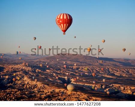Cappadocia / Turkey -10 07 2013: Tourism in Cappadocia, Turkey. Tourists on sightseeing tour traveling around. #1477627208