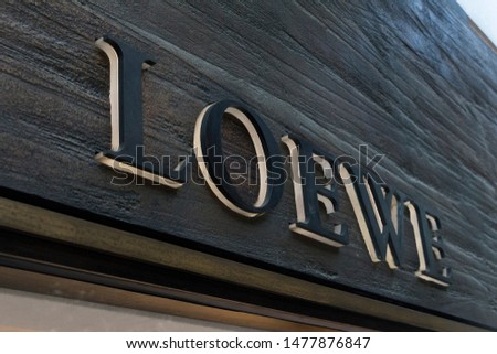 VALENCIA, SPAIN - JULY 18, 2019. Loewe logo on Loewe building. Loewe is a Spanish luxury fashion house #1477876847