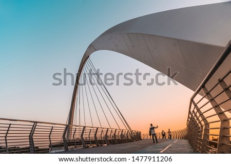 Famous Travel Tourist spot in Dubai Water Canal Bridge, Colorful sunset view from famous architecture Bridge,  #1477911206