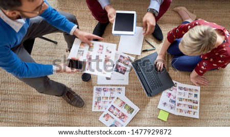 Multi-ethnic team of creative millenials collaborating on a brainstorm project #1477929872